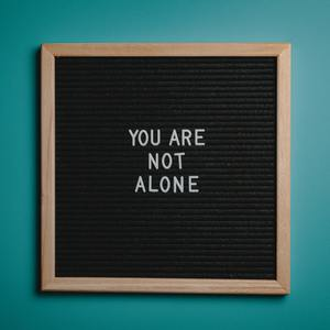 You Are Not Alone Quote Board On Brown Wooden Frame 2821220